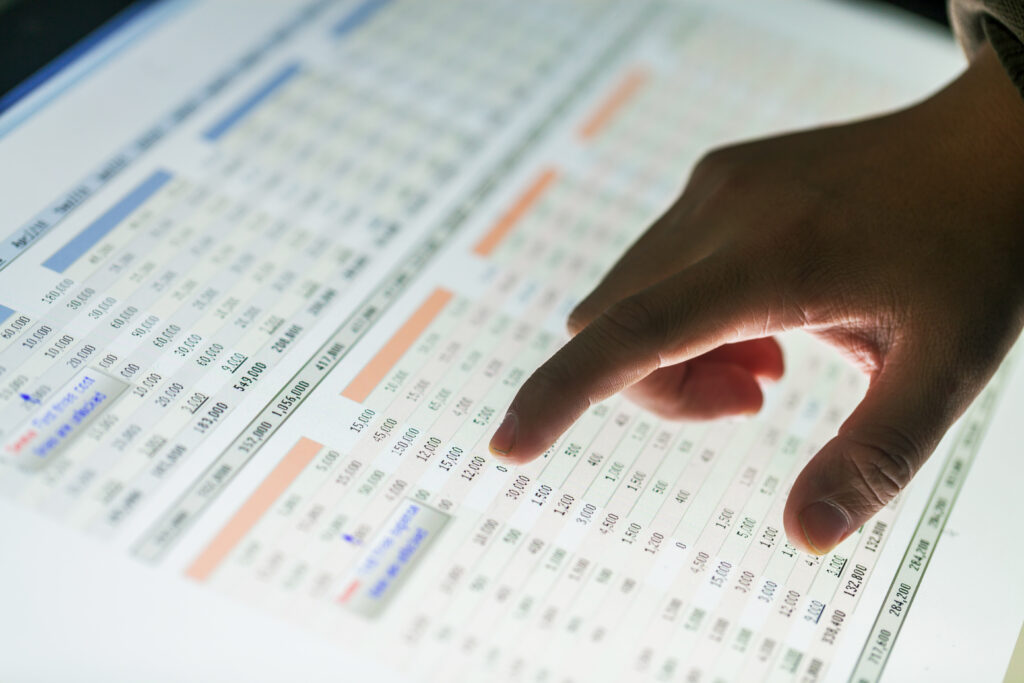 hand point on data report show on screen